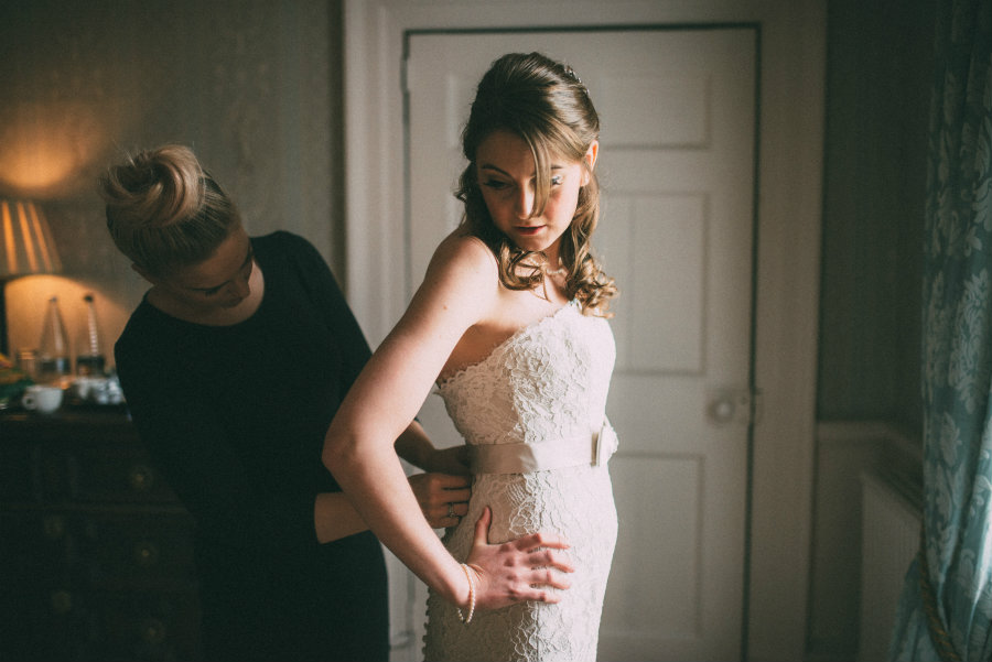 Myself helping Vicky button her dress.